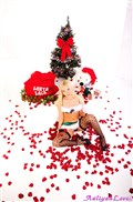 Aaliyah Love strips down next to a Christmas tree from Aaliyah Love