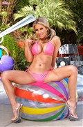 Ainsley Addison plays around in her pink bikini from Twisty's