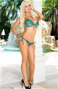 Alexis Ford strips off her turquoise lingerie by the pool from Penthouse