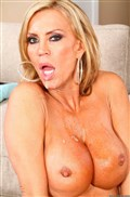 Amber Lynn sexy housewife takes on a fat cock