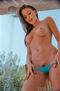 Amber Sym takes an outdoor shower in her amazing bikini