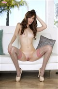 Aria Amor touches herself in pink lingerie and stockings from Twisty's