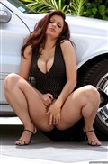 Aria Giovanni poses nude on a Mercedes Benz Picture 12