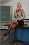 Ashley Fires gets screwed on a school desk in stockings from Naughty America