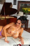Ava Addams fucked by her masseur in a purple top from Digital Playground