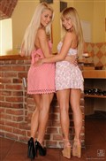 Bella Baby and Pinky June lick pussies in pink dresses