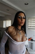 Bella DellaMorte toys her ass in fishnet suit Picture 04