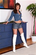 Betty Saint takes on two cock at once in her white boots from evilangel