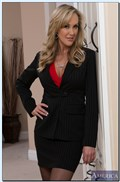 Brandi Love gets drilled in her suit and black stockings from Naughty America