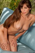Capri Anderson strips off her orange top and shows tits from Digital Desire