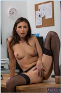 Casey Calvert gets fucked on her desk in black stockings from Naughty America