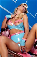Cherie Deville plays with a pink dildo in crotchless latex from Brand Danger