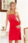 Cikita busty blonde removes her red dress and poses