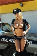 Clara G strips off her police uniform and dildos on a car from 21 Sextury