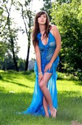 Conny rips off her blue dress in the sunny fields