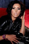 Dylan Ryder poses on a motorcycle in a leather jacket from Dylan Ryder