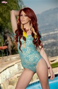 Elle Alexandra rubs her pussy by the pool in blue bodysuit