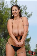 Eva Notty shows off her big tits in a bikini at the pool from DDF Prod