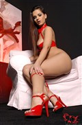 Eve Angel uses a dildo in her red latex cutout outfit from DDF Prod