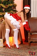 Eve Angel looks cute by the Christmas tree in a red dress from DDF Prod