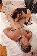 Gianna Michaels uses a whip on a guy while sucking cock from DDF Prod