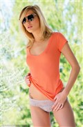 Hayden Hawkens strips off her sexy orange shirt outdoors