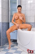 Jasmine Jae touches herself in a soapy warm bath
