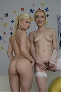 Jessie Volt and Lily LaBeau flash their sweet pussies to you from evilangel