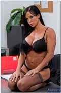 Jewels Jade rides dick on a classroom desk in stockings from Naughty America