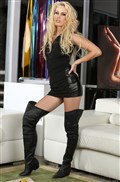 Kiara Diane strips off her black dress in thigh high boots
