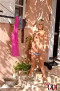 Laura Crystal hangs her laundry outside in the nude from DDF Prod