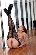 Lexi Bloom fingers herself on a pole in black stockings