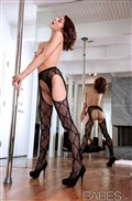 Lexi Bloom fingers herself on a pole in black stockings from Babes