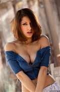 Lexi Bloom strips off her cute blue top outdoors