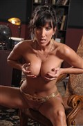Lezley Zen shows off her big tits and gets banged on a desk