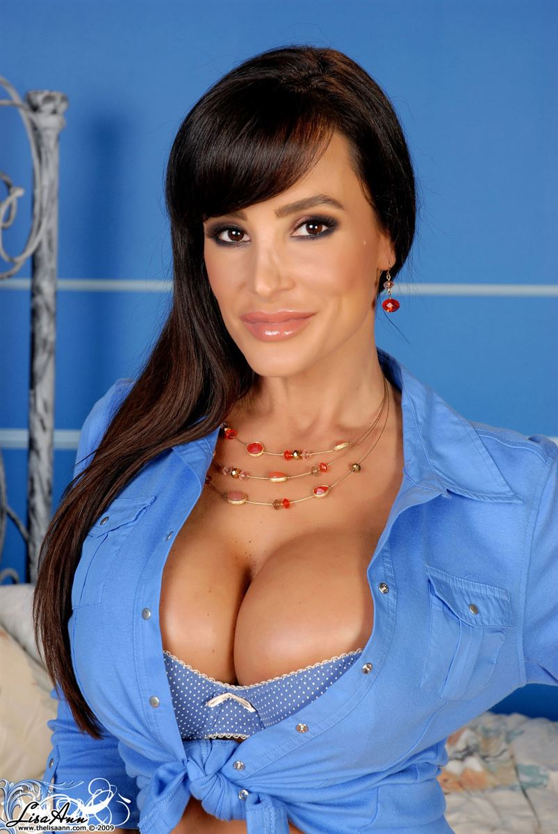 Lisa Ann masturbates with a dildo in her blue bra Main Image
