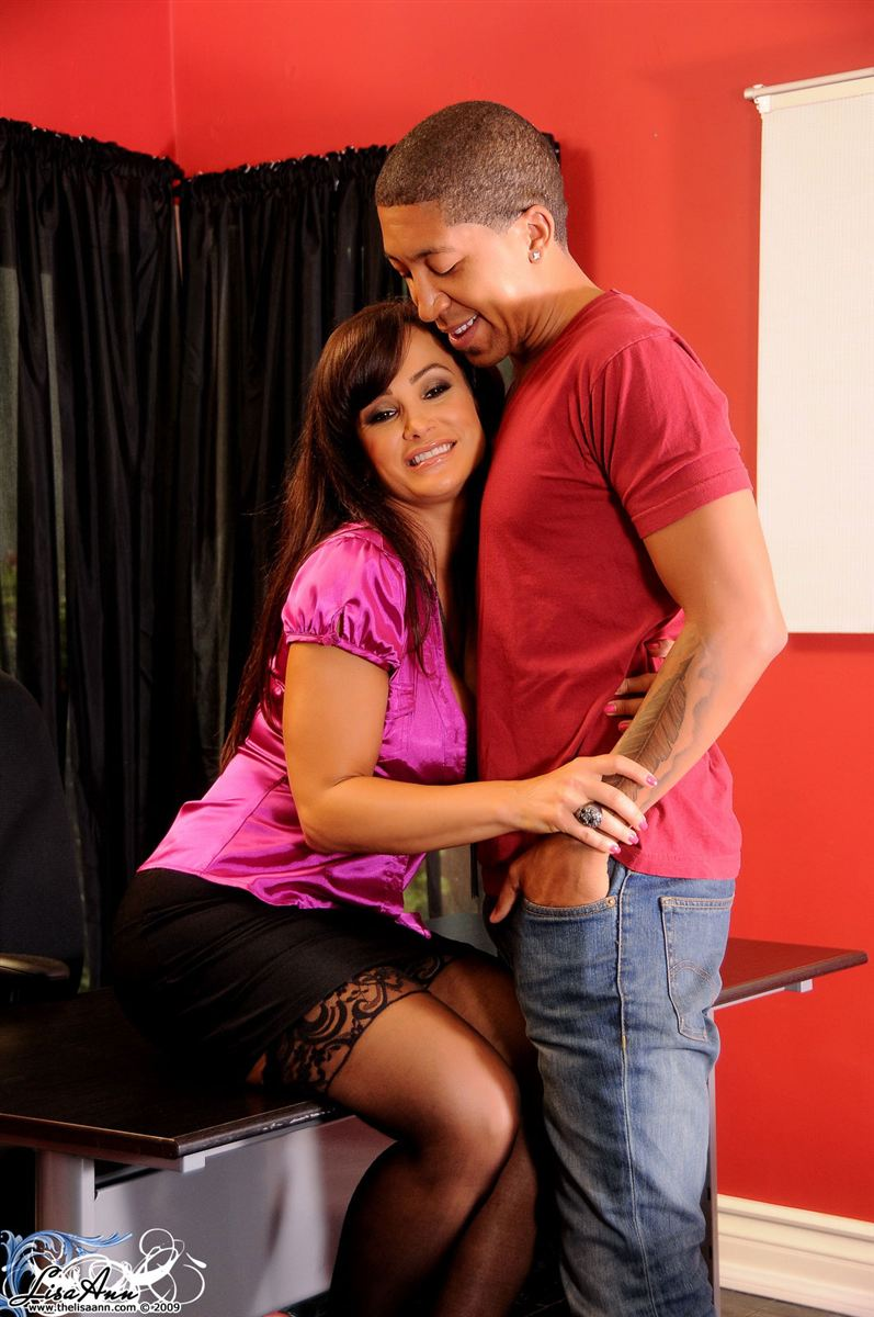 Lisa Ann rides dick on an office chair in black stockings Main Image