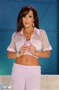 Lisa Ann shows off her stunning curves in a pink outfit from Brand Danger
