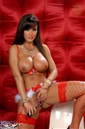 Lisa Ann looks sexy in a red and white Christmas outfit Picture 14