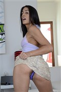 Lyla Storm strips off her shiny gold skirt and thong from evilangel