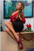 Madison Ivy screws on her office desk by a Christmas tree from Naughty America
