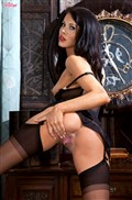 Megan Coxxx rubs her pussy in black corset and stockings