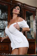 Rachel Aziani plays with a dildo in her white legwarmers from Aziani
