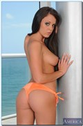 Rahyndee gets banged in her very sexy orange bikini from Naughty America
