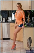 Samantha Saint gets drilled in the kitchen in pink lingerie from Naughty America