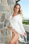 Samantha Saint poses sexy outside in a white shirt from Penthouse
