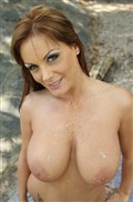 Sheila Grant titty fucks a hard cock outside in nature from evilangel
