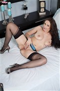Sophia Delane rubs her pussy in blue lingerie and stockings