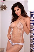 Sunny Leone poses naked on the staris in body jewelry from Twisty's