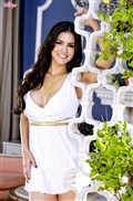 Sunny Leone shows off her stunning figure in a white dress from Twisty's